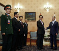Russia 's PM Dmitry Medvedev shakes hands with Vietnam's PM Nguyen Tan Dung during a meeting in Moscow