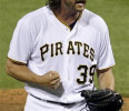 Pittsburgh Pirates closer Jason Grilli celebrates after getting the final out of a 5-4 win over the Chicago Cubs in a baseball game in Pittsburgh Tuesday, May 21, 2013. Grilli got a major league ...
