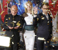 "Confetti flies as Robert Downey Jr ., Gwyneth Paltrow and Ben Kingsley pose at the premiere of ""Iron Man 3"" in Hollywood"