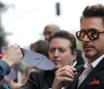 "Cast member Robert Downey Jr . signs autographs at the premiere of ""Iron Man 3"" in Hollywood"