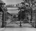 FILE - An undated image shows the main gate of the Nazi concentration camp Auschwitz in Poland, which was liberated by the Russians, January 1945. Writing over the gate reads: &quot;Arbeit macht frei ...
