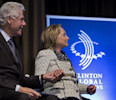 Former President Bill Clinton and former Secretary of State Hillary Clinton holds hands after she introduced Rio de Janiero Mayor Eduardo Paes at the Clinton Global Initiative (CGI) Mid-Year Meeting ...