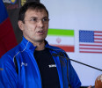 Russia Olympic Wrestling coach Christakis Alexandris addresses other coaches and wrestlers though an interpreter during a news conference at U.N. headquarters, Tuesday, May 14, 2013, announcing the ...
