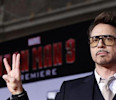 "Cast member Robert Downey Jr . poses at the premiere of ""Iron Man 3"" in Hollywood"