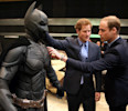 "Britain's Prince William , right, and his brother Prince Harry look at a 'Batsuit' used in the Batman films as they and Kate the Duchess of Cambridge, not pictured, attend the inauguration of ""Warner ..."