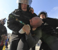 Riot police detain a supporter of Ukraine's opposition after a rally in Kiev