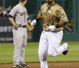 Pittsburgh Pirates ' Pedro Alvarez, right. rounds the bases past Houston Astros third baseman Matt Dominguez after hitting s two-run home run to tie the baseball game in the eighth inning Friday, May ...