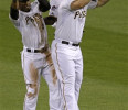 Pittsburgh Pirates outfielders Starling Marte, left, Andrew McCutchen, center, and Travis Snider celebrate after a 5-4 win over the Chicago Cubs in a baseball game in Pittsburgh Tuesday, May 21, 2013