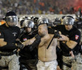 Serbian riot police officers arrest a Partizan soccer fan during a Serbian National league soccer match Partizan against Red Star, in Belgrade, Serbia, Saturday, May 18, 2013. Thousands of riot ...