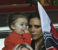 Victoria Beckham with her daughter Harper arrives prior to Paris Saint-Germain's French League One soccer match against Brest, at Parc des Princes Stadium, in Paris, Saturday, May 18, 2013. Paris ...