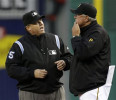 Pittsburgh Pirates manager Clint Hurdle, right, talks with first base umpire Fieldin Culbreth about an out called at first base on Pirates ' Andrew McCutchen in the fourth inning of a baseball game ...