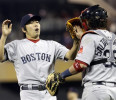 Boston Red Sox catcher Jarrod Saltalamacchia returns the ball to pitcher Koji Uehara of Japan as they celebrate the final out as the Red Sox beat the Minnesota Twins 3-2 in 10 innings of a baseball ...