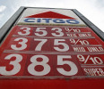 FILE - In this Friday, April 19, 2013, photo, Gas prices are displayed on in Montpelier, Vt. A sharp decline in the price of oil this month is making gasoline cheaper at a time of year when it ...