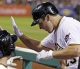 Pittsburgh Pirates &#39; Travis Snider, right, returns to the dugout after hitting a two-run home run off Milwaukee Brewers starting pitcher Hiram Burgos in the fifth inning of a baseball game in ...