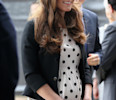 FILE - This is a Friday, April 26, 2013 file photo of Britain's Kate the Duchess of Cambridge arrives with her husband Prince William , not pictured and his brother Prince Harry, rear right, to ...
