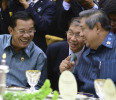 Cambodia 's PM Sen and Indonesia's President Yudhoyono share a light moment during their working dinner at the ASEAN Summit in the Prime Minister's Office in Bandar Seri Begawan