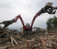 A rescue robot works on destroyed houses after last Saturday's earthquake in Lushan county, Ya'an