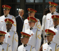 Former U.S. president George W . Bush walks behind a military choir at the end of a dedication ceremony for the George W . Bush Presidential Center in Dallas