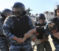 Riot police detain supporters of Ukraine's opposition after a rally in Kiev