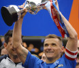 Glasgow Rangers' captain McCulloch lifts the league trophy after beating Berwick Rangers in their Scottish 3rd Division soccer match in Glasgow