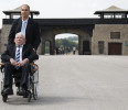 Concentration camp survivor Spitzer from Israel sits in a wheelchair in front of the entrance of former concentration camp Mauthausen