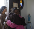 Elaine dos Santos who is homeless , receives a hug from a Franciscan nun in Rio de Janeiro