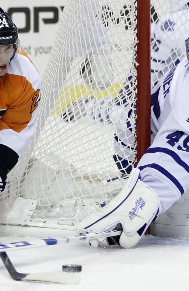 Philadelphia Flyers' Matt Read, left, tries to get a shot past Toronto Maple Leafs' Jonathan Bernier during the second period of an NHL hockey game on Wednesday, Oct. 2, 2013, in Philadelphia