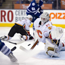 Calgary Flames goaltender Karri Ramo makes a save on Toronto Maple Leafs right winger Phil Kessel during second period NHL action in Toronto on Tuesday April 1, 2014 The Associated Press