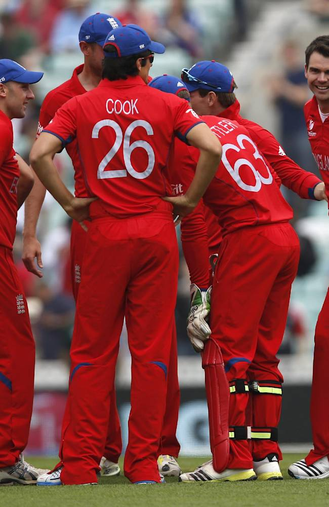 England's James Anderson, right, celebrates the wicket of South Africa's Colin Ingram by lbw with teammates during their ICC Champions Trophy semifinal cricket match at the Oval cricket ground in London, Wednesday, June 19, 2013