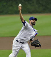 Chicago Cubs' Carlos Villanueva pitches against the Milwaukee Brewers during the first inning of a baseball game Tuesday, July 30, 2013, in Chicago. (AP Photo/Jim Prisching)