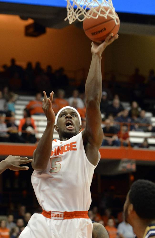 Syracuse's C. J. Fair scores against Ryerson during the second half of a men's NCAA exhibition basketball game in Syracuse, N.Y., Tuesday, Nov. 5, 2013. Syracuse won 81-46