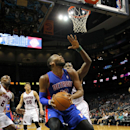 Detroit Pistons forward Greg Monroe (10) looks for his shot as Atlanta Hawks forward Elton Brand (42) defends during the second period of an NBA basketball game in Atlanta, Tuesday, April 8, 2014. The Pistons won the game 102-95 The Associated Press