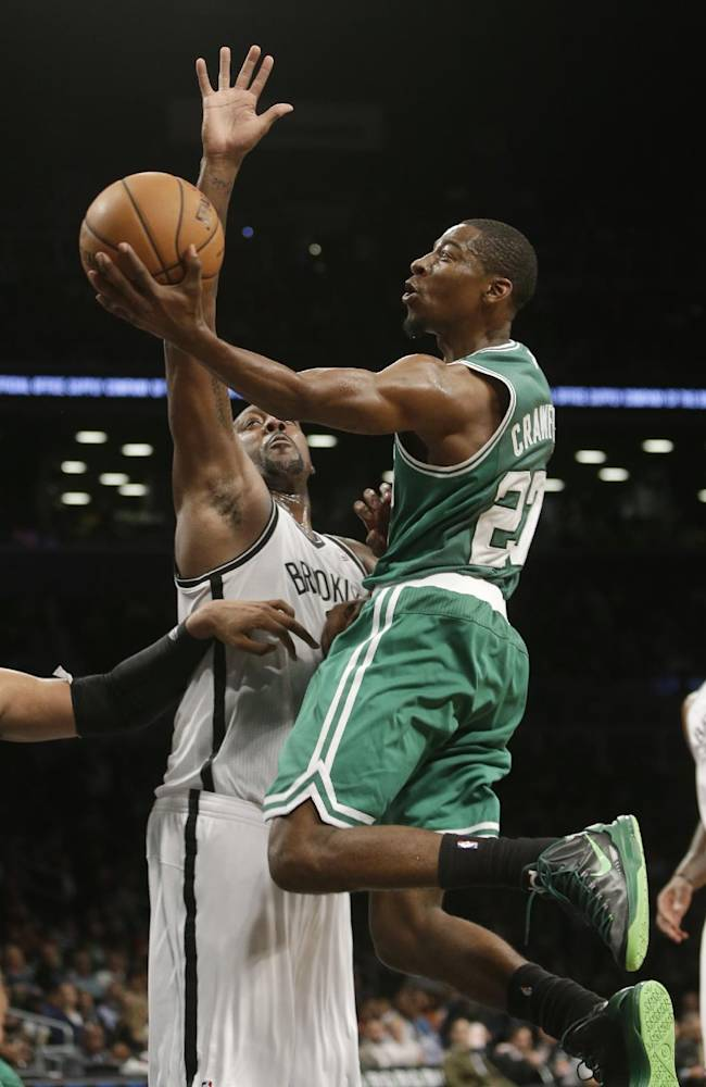 Boston Celtics' Jordan Crawford (27) drives to the basket as Brooklyn Nets' Andray Blatche defends during the second half of a preseason NBA basketball game Tuesday, Oct. 15, 2013, in New York.  The Nets won 82-80