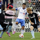 Montreal Impact midfielder Dilly Duka (11), center, controls the ball against Chicago Fire midfielder Patrick Nyarko, left, and midfielder Jeff Larentowicz (20) during the first half of an MLS soccer game on Sunday, Oct. 5, 2014, in Bridgeview, Ill The As