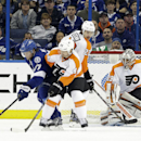 Tampa Bay Lightning defenseman Victor Hedman (77), of Sweden, prepares to score a goal past Philadelphia Flyers defenseman Kimmo Timonen (44), of Finland, defenseman Luke Schenn (22) and goalie Ray Emery (29) during the third period of an NHL hockey game