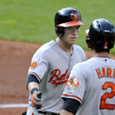 Baltimore Orioles' Nate McLouth, left, celebrates his two-run home run with J.J. Hardy in the fourth inning against the Cleveland Indians during a baseball game, Monday, Sept. 2, 2013, in Cleveland. (AP Photo/David Richard)