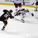 Anaheim Ducks center Ryan Getzlaf, left, scores an empty-net goal past Columbus Blue Jackets center Mark Letestu during the third period of an NHL hockey game in Anaheim, Calif., Friday, Oct. 24, 2014. The Ducks won 4-1 The Associated Press