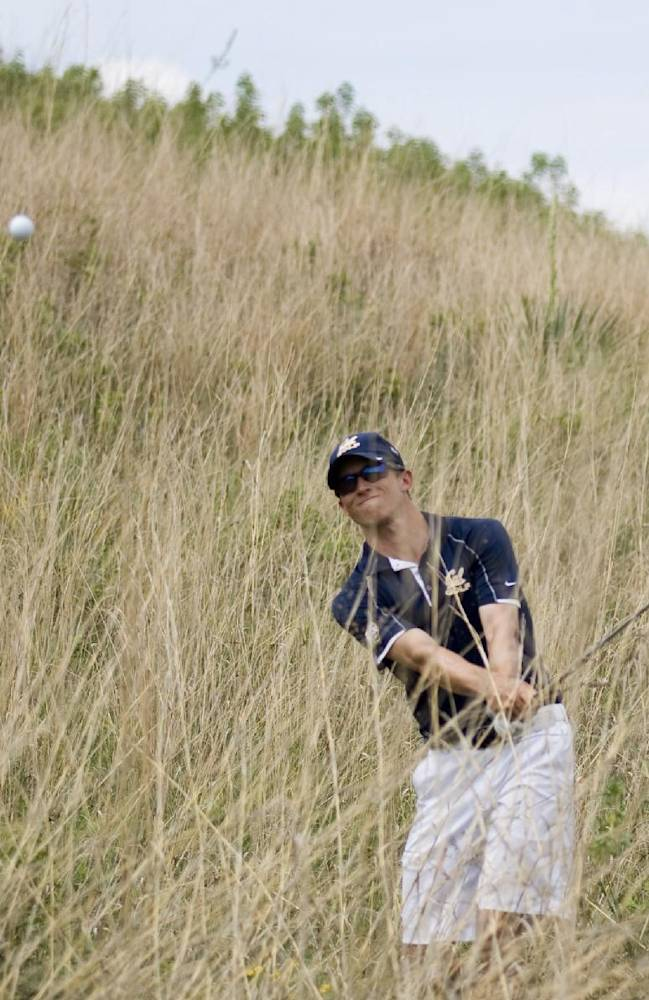California's Brandon Hagy hits ball from off the fairway on No. 17 during the NCAA Division I men's golf championships at Prairie Dunes Country Club in Hutchinson, Kan., on Saturday, May 24, 2014