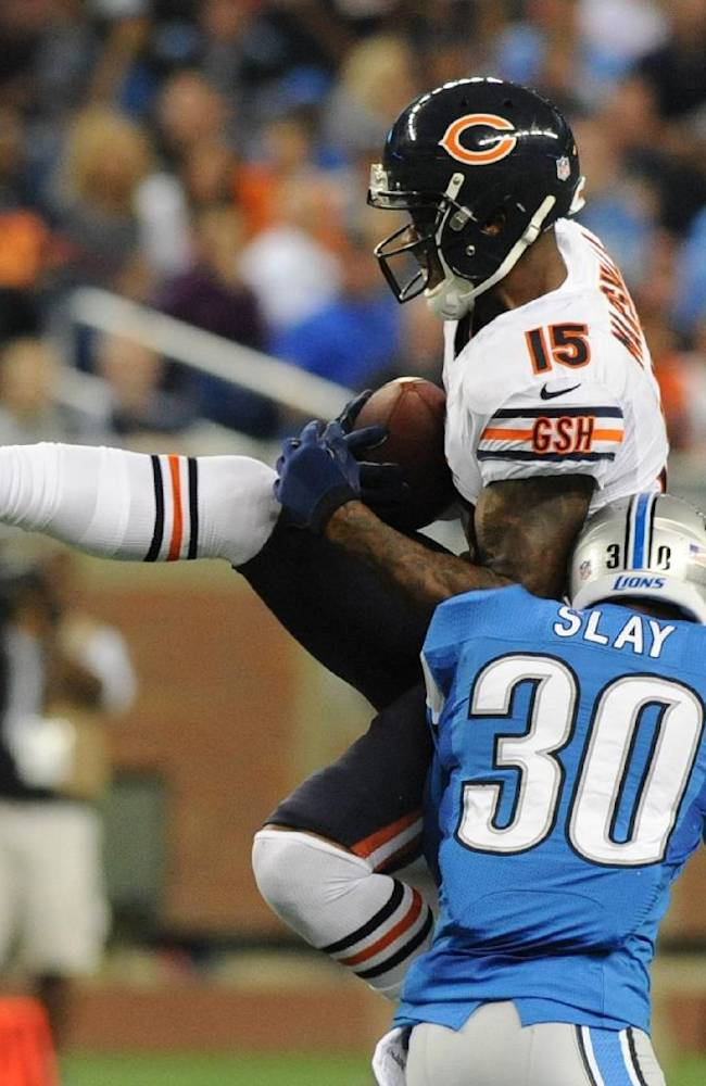Chicago Bears wide receiver Brandon Marshall (15) is stopped by Detroit Lions cornerback Darius Slay (30) after a 24-yard reception during the third quarter of an NFL football game at Ford Field in Detroit, Sunday, Sept. 29, 2013