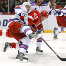 New York Rangers defenseman Ryan McDonagh (27) and Detroit Red Wings center Darren Helm (43) battle for the puck in the second period during an NHL hockey game in Detroit, Saturday, Dec. 6, 2014 The Associated Press