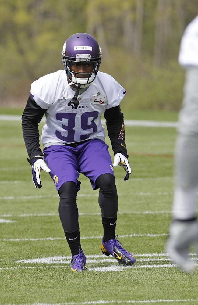 Cornerback Jabari Price takes part in a drill during Minnesota Vikings mini camp in Eden Prairie, Minn., Friday, May 16, 2014. New Vikings coach Mike Zimmer set to work getting young players like quarterback Teddy Bridgewater, linebacker Anthony Barr and defensive backs Antone Exum and Kendall James up to speed on what will be expected of them in the NFL