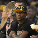 FILE - In this Nov. 24, 2013, file photo, Boxer Floyd Mayweather Jr. watches the Los Angeles Lakers play the Sacramento Kings during the first half of an NBA basketball game in Los Angeles. If Donald Sterling is compelled to sell the Los Angeles Clippers, the list of potential buyers will have more stars than the team's roster. Mayweather Jr. wants to form a group to buy the team. (AP Photo/Mark J. Terrill, File)