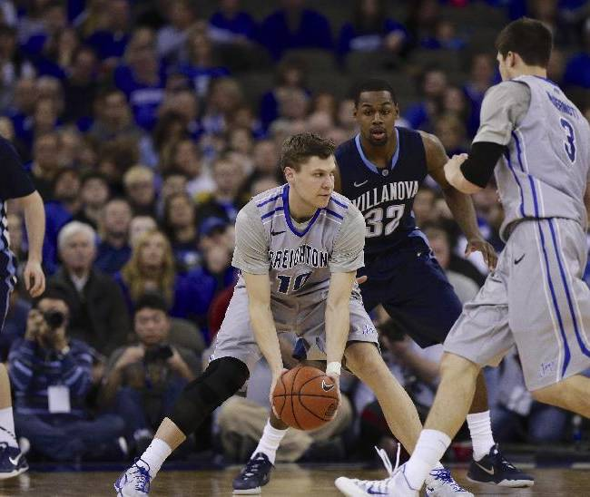 In this file photo from Feb. 16, 2014, Creighton's Grant Gibbs (10) looks to pass the ball to teammate Doug McDermott (3) against Villanova's James Bell (32) as Villanova's Ryan Arcidiacono (15) looks on, in the second half of an NCAA college basketball game in Omaha, Neb. With Gibbs as his wingman for three years, McDermott has ascended to near the top of the NCAA's all-time scoring chart. The two share an uncommon connection on the court, and off the court, they're best buddies