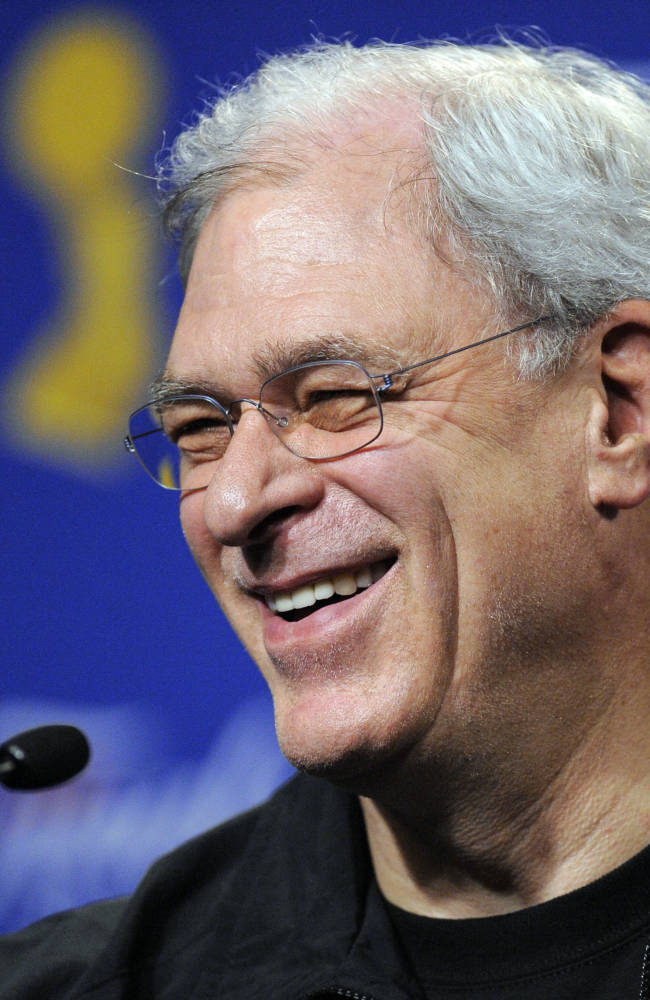 In this June 3, 2009 file photo, Los Angeles Lakers coach Phil Jackson answers question during a news conference after practice for Game 1 of the NBA final basketball series in Los Angeles. Carmelo Anthony says he has heard that 11-time NBA champion coach Phil Jackson will be