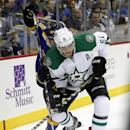 St. Louis Blues defenseman Petteri Lindbohm (48) and Dallas Stars center Tyler Seguin (91) battle for control of the puck in the second period of a preseason NHL hockey game at the Sprint Center in Kansas City, Mo., Saturday, Sept. 27, 2014. The Associate