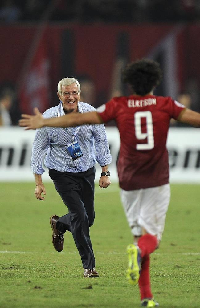 Elkeson De Oliveira Cardoso of China's Guangzhou Evergrande, right, runs towards to his coach Marcello Lippi, center, after they won the final match against South Korea's FC Seoul at the 2013 Asian Champions League final at Tianhe stadium in Guangzhou in south China's Guangdong province, Saturday, Nov. 9, 2013. Guangzhou Evergrande became the first Chinese team since 1990 to win the Asian Champions League by drawing 1-1 with FC Seoul in the second leg of the final on Saturday, claiming the title on away goals after the first game in South Korea ended 2-2. (AP Photo)