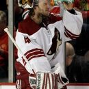Phoenix Coyotes goalie Mike Smith (41) cools off during the first period of Game 6 of an NHL hockey Stanley Cup first-round playoff series against the Chicago Blackhawks in Chicago, Monday, April 23, 2012.  (AP Photo/Nam Y. Huh)