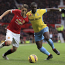 Crystal Palace's Yannick Bolasie, right, and Manchester United's Adnan Januzaj battle for the ball during their English Premier League match at Old Trafford, Manchester England Saturday Nov. 8, 2014