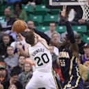 Utah Jazz's Gordon Hayward (20) shoots as Indiana Pacers' Roy Hibbert (55) defends in the first quarter during an NBA basketball game Wednesday, Dec. 4, 2013, in Salt Lake City The Associated Press