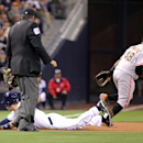 San Diego Padres' Chris Denorfia slides in with a triple as San Francisco Giants third baseman Pablo Sandoval waits for the throw during the first inning of a baseball game Friday, April 18, 2014, in San Diego The Associated Press
